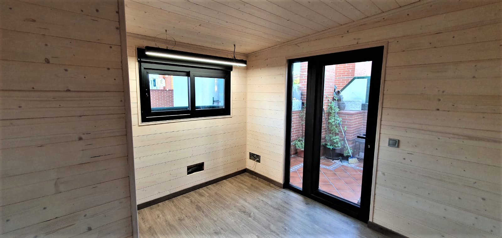 Interior caseta madera habitable 9m2 Caseta Living